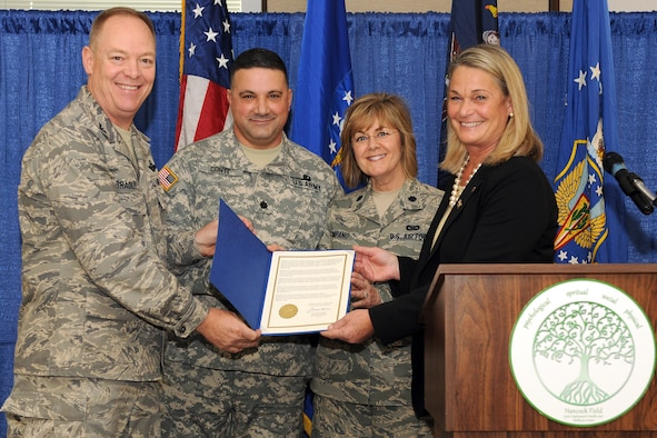 "New York Congresswoman Ann Marie Buerkle presents the 174th Fighter Wing Commander, Col. Kevin Bradley, Lt. Col. Maryjo Timpano, and Army Lt. Col. Conte with a letter certifying the opening of the Hancock Field Joint Heath and Wellness Center facility.  The newly opened J-HAWC is a ""one stop shop"" for all Hancock Field members and family. The J-HAWC Provides many services in one central location, ranging from mental well-being to financial services to fitness programs and family services. The ribbon cutting cermony of the new Hancock Field, J-HAWC facilitly took place on 4 December 2011. (USAF Photo by:SSgt James N Faso II/RELEASED)"