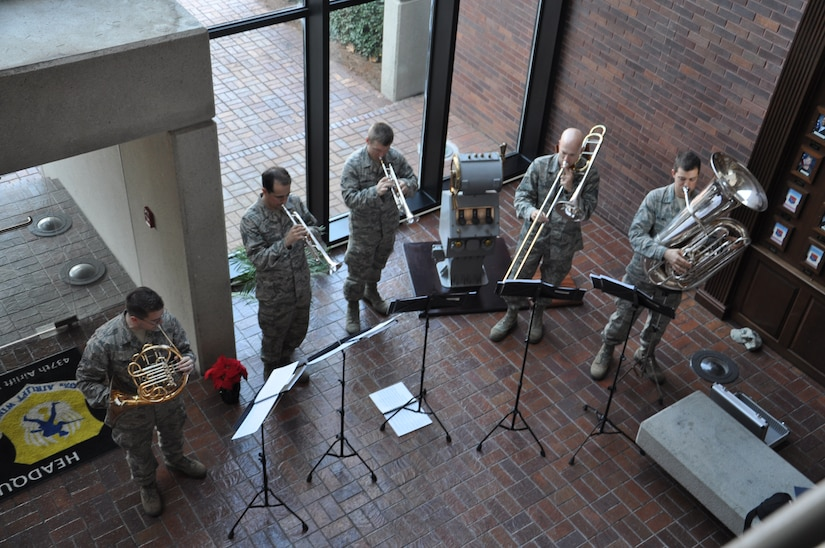 Members of the Air Force Heritage Band play their instruments on tour of Joint Base Charleston  -Air Base Dec. 9. The AF Heritage Band toured JB Charleston to spread holiday cheer with playing Christmas carols. (U.S. Air Force photo/Lt. Leah Davis)