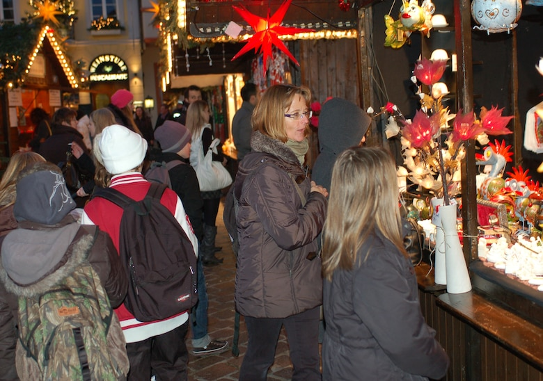 SPANGDAHLEM AIR BASE, Germany -- Visitors buy holiday gifts at Trier's Weihnachtsmarkt Dec. 8 in the main market square in Trier. The market continues now through Dec. 22. Opening times are 10:30 a.m. - 8:30 p.m. Monday through Wednesday, 10:30 a.m. - 9:30 p.m. Thursday through Saturday, and 11 a.m. - 8:30 p.m. Sunday. Highlights include a performance by the U.S. Air Forces in Europe Brass Band from 6 - 7 p.m. Dec. 13. Music and entertainment is scheduled throughout each weekend, and Sankt Nikolaus will visit often. (U.S. Air Force photo/Iris Reiff)