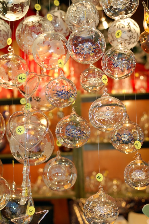 SPANGDAHLEM AIR BASE, Germany -- Glass decorative holiday ornaments hang from a sales booth at Trier's Weihnachtsmarkt Dec. 8 in the main market square in Trier. Many different kinds of handmade wood, straw and glass ornaments are sold at this market now through Dec. 22. Opening times for the market are 10:30 a.m. - 8:30 p.m. Monday through Wednesday, 10:30 a.m. - 9:30 p.m. Thursday through Saturday, and 11 a.m. - 8:30 p.m. Sunday. Highlights include a performance by the U.S. Air Forces in Europe Brass Band from 6 - 7 p.m. Dec. 13. Music and entertainment is scheduled throughout each weekend, and Sankt Nikolaus will visit often. (U.S. Air Force photo/Iris Reiff)