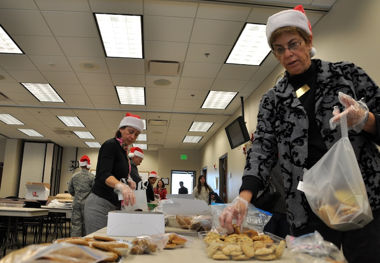 BUCKLEY AIR FORCE BASE, Colo. –- Volunteers from Buckley AFB bag cookies at the Chapel for this year's Cookie Caper Dec. 8. The cookies were packaged into over 350 bags and distributed to Team Buckley members. (U.S. Air Force photo by Senior Airman Elisa Labbe)