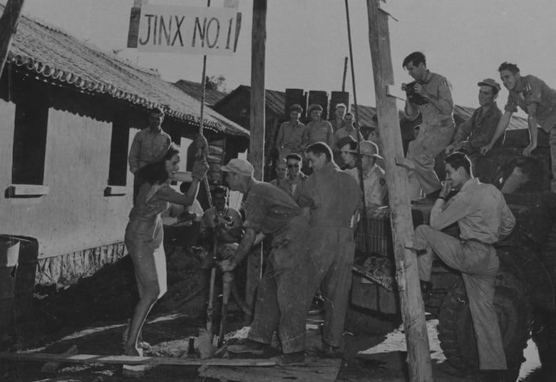 Squadron members happily receive help from Jinx on facility improvements in China during her USO tour to the CBI in late 1944.