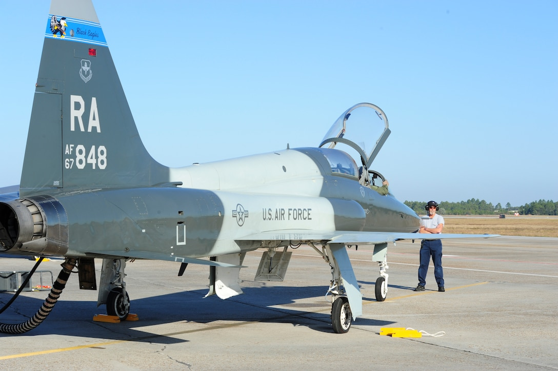 Bill Monk, 12th Maintenance Directorate, waits to marshall the T-38C Talon piloted by Capt. Kevin Welsh, 435th Fighter Training Squadron, prior to take off at Tyndall Air Force Base, Fla., Dec. 15, 2011.  The 12th Flying Training Wing sent a group of 13 pilots and maintainers and five T-38C Talons from Randolph to Tyndall to assist the 325th Fighter Wing in a training exercise.  (U.S. Air Force Photo by LIsa Norman)