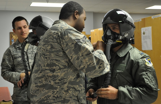 LAUGHLIN AIR FORCE BASE, Texas—Senior Airman Richard Weatherby,47th Operations Support Squadron, and Airman 1st Class Alexander King, 47th OSS, prepare to test the masks on two Afghan lieutenants going through Specialized Undergraduate Pilot Training. Three Afghan lieutenants are the first from Afghanistan to attend SUPT at Laughlin and are scheduled to graduate here Dec. 16. (U.S. Air Force photo/2nd Lt. Angela Martin)