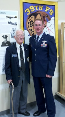 Retired Col. Frank Royal and Lt. Col. Roger Suro, 39th Flying Training Squadron commander, pose for a photo before the squadron's 70th anniversary banquet in Bellingham, Wash., Oct. 15, 2011.  Col. Royal, then a second lieutenant, was one of the commanders for the squadron and led the unit to the South Pacific where they would go on to become one of the most-decorated squadrons of World War II.  (Courtesy Photo)