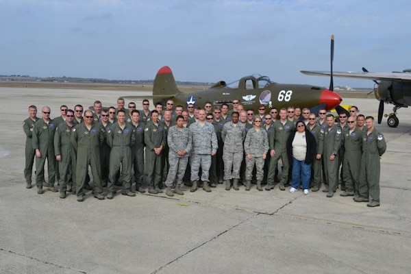 Current members of the 39th Flying Training Squadron pose for a group photo in front of a P-39, the airframe assigned to the unit while it conducted antisubmarine patrols along the West Coast in the days and weeks following the attack on Pearl Harbor.  As a reserve associate unit to the 12th Flying Training Wing, the now 39th FTS was moved to Randolph AFB, Texas in September 2007 and trains instructor pilots.(Courtesy Photo)