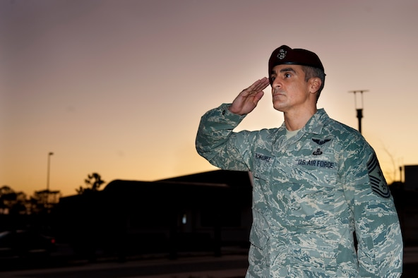 U.S. Air Force Chief Master Sgt. Ramon Colon-Lopez, command chief of the 1st Special Operations Wing, renders a salute during retreat at wing headquarters at Hurlburt Field, Fla., Dec. 14, 2011. Colon-Lopez assumed leadership as command chief from retired Chief Master Sgt. Dexter Mitchell Nov. 30, 2011. (U.S. Air Force photo/Airman 1st Class Christopher Williams)(Released)