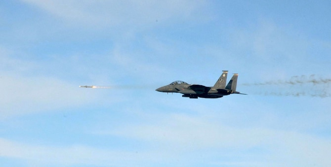 An F-15E Strike Eagle from Mountain Home Air Force Base, Idaho, fires a missile while participating in a training exercise during Combat Archer at Tyndall Air Force Base, Fla., Dec. 6, 2011. Throughout the exercise, the 389th Fighter Squadron fired 23 missiles with zero range-safety violations and the 389th Aircraft Maintenance Squadron was evaluated 218 separate times and also had zero discrepancies. (Courtesy photo)