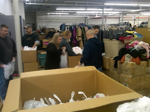 Members of the 343rd Recruiting Squadron sort donated clothes at the Open Door Mission in Omaha