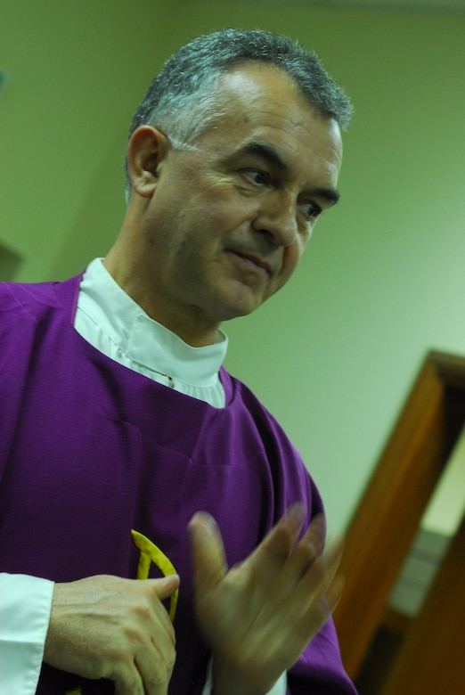 Chaplain (Lt. Col.) Jacek Kowalik, 332nd Air Expeditionary Wing Catholic priest, offers a benediction at a Mass held Nov. 28, 2011 at an undisclosed location in Southwest Asia. Kowalik is a native of Parszow, Poland and is deployed from Spangdahlem Air Base, Germany. (U.S. Air Force photo by 1st Lt. Rusty Ridley)