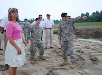 "Col. Vernie Reichling (right), Commander of the U.S. Army Corps of Engineers Memphis District, points out a feature of the inflow crevasse at the north end of the mainline levee on the Birds Point-New Madrid Floodway to (left to right) U.S. Representative Jo Ann Emerson, Maj. Gen. Merdith ""Bo"" Temple, Deputy Commanding General of the U.S. Army Corps of Engineers, Darren Lingle of Representative Emerson's staff, and Steven Barry, the Corps' Memphis District Chief of Emergency Operations. (U.S. Army Corps of Engineers photo)"