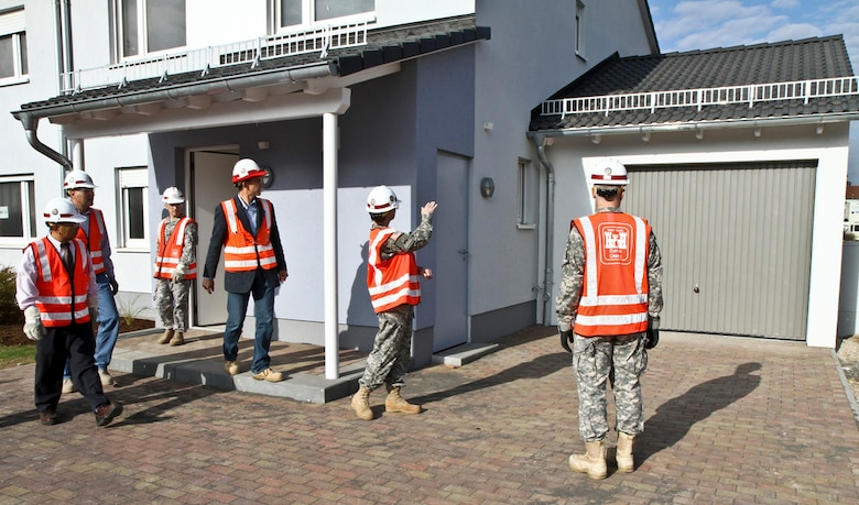 WIESBADEN, Germany — Lt. Col. Michelle Garcia (middle), U.S. Army Corps of Engineers Europe District deputy commander, explains design elements of the newest military housing units near the Wiesbaden Army Airfield to Maj. Gen. Jeffrey Dorko (right), USACE deputy commanding general of military and international operations, during a tour of the construction site Oct. 31, 2011. (U.S. Army Corps of Engineers photo by Carol E. Davis)