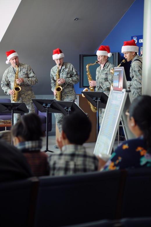 Saxophone players from the U.S. Air Force Band of the Golden West, based at Travis Air Force Base, Calif., entertain members of the US Air Force Space and Missile Systems Center, El Segundo, Calif., Dec. 9, 2011.