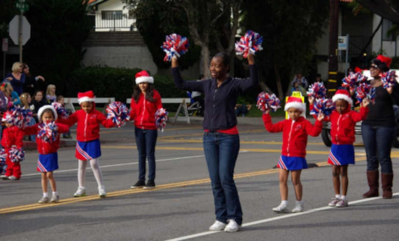 The LAAFB Youth Programs Cheerleading Squad performs for the crowd during the 48th annual El Segundo Holiday Parade, Dec. 11. This year was the second year the squad marched in the El Segundo parade. (Photo by Alicia Garges)