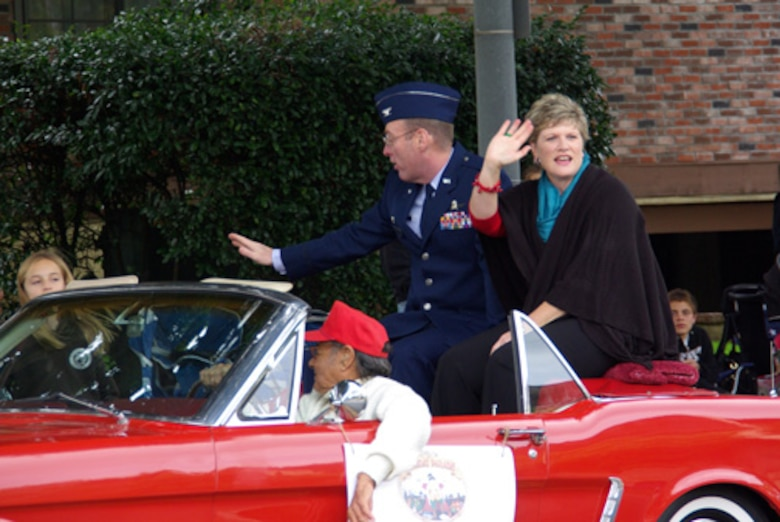 "61st Air Base Group Commander, Col. Frank Simcox and his wife wave to the crowds during the El Segundo Holiday Parade, Dec. 11. Celebrating ""100 years of holidays,"" this year's parade was the city's 48th annual. (Photo by Alicia Garges)"