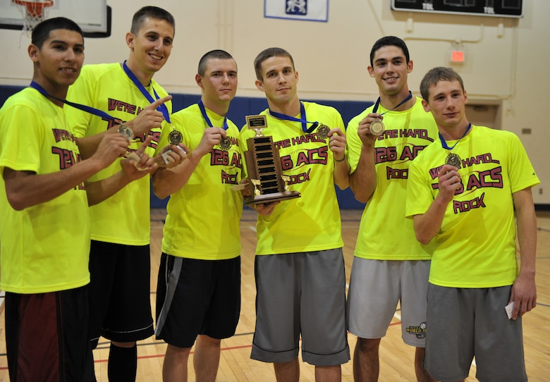 Players from the 726th Air Control Squadron show off the medals and trophy they received for winning the Inaugural Jingle Bell Dodgeball Tournament Dec. 15, 2011, at Mountain Home Air Force Base, Idaho. The tournament consisted of 13 six-player teams. (U.S. Air Force photo/Airman 1st Class Heather Hayward)