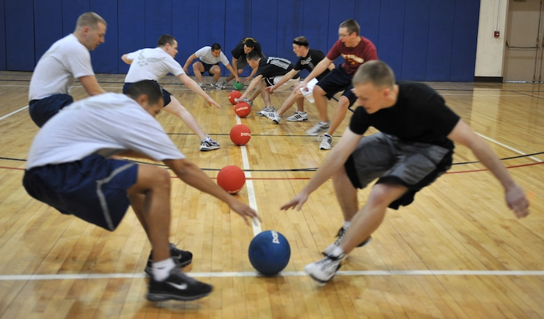 Players race to grab the dodgeballs at the start of the match during the inaugural Jingle Bell Dodgeball Tournament Dec. 15, 2011, at Mountain Home Air Force Base, Idaho.  During the tournament National Dodgeball League rules were used to ensure consistency. (U.S. Air Force photo/Airman 1st Class Heather Hayward)