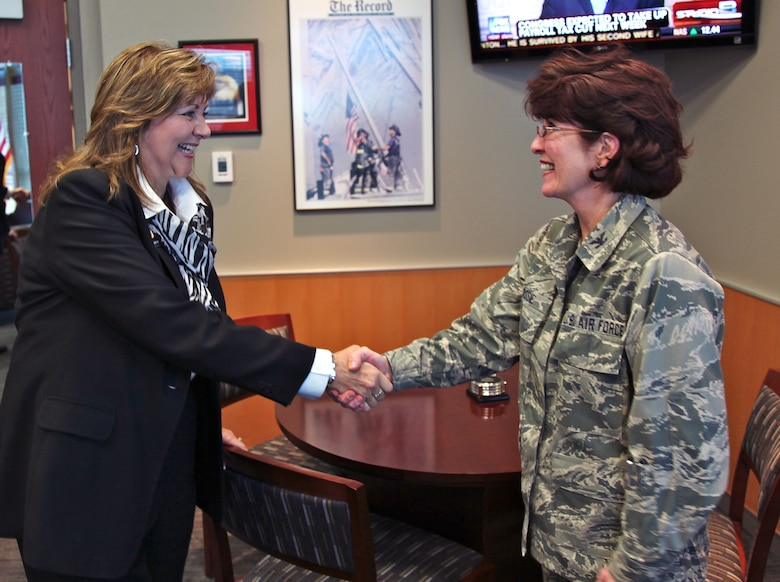 B.J. Nikkel, incumbent Colorado state representative, is greeted by Col. Pat Blassie, Air Reserve Personnel Center Commander, during the representative's first visit to ARPC headquarters Dec. 16, 2011, on Buckley Air Force Base, Colo. Nikkel represents House District 49, which includes all of rural Larimer County, Colorado. She was appointed to the Colorado House of Representatives in January 2009. (U.S. Air Force photo/Quinn Jacobson)