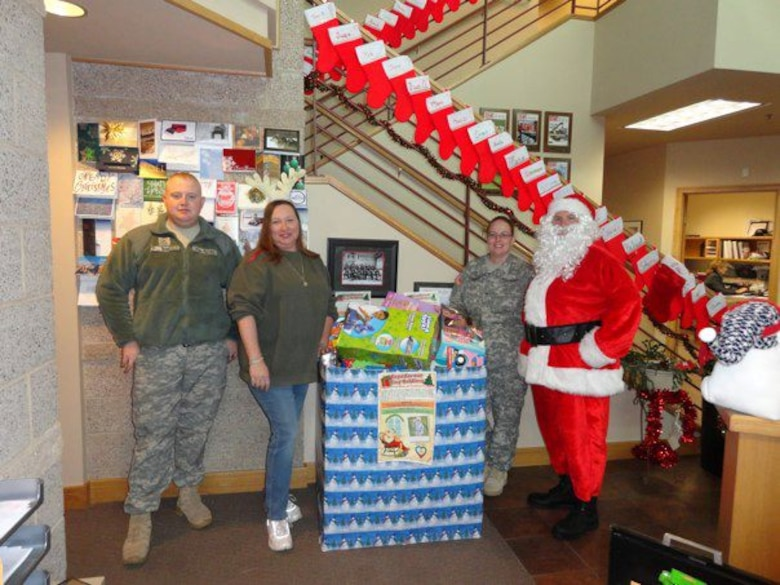 """Santa and a few of his elves stand ready to deliver toys to tiny """"soldiers"""" in Grand Junction, Colo. (Photo provided by Danielle Hindson/Used with permission)"""