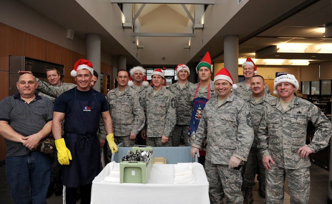 The Chiefs of Hancock Field Air National Guard Base take part in the annual Chief's breakfast at Hancock Field Air National Guard Base in Syracuse, NY on 16 December 2011.  This is an annual event where all Hancock Field members have a chance to be served breakfast by the Chiefs. (Photo by US Air Force Technical Sgt. Ricky Best/RELEASED)