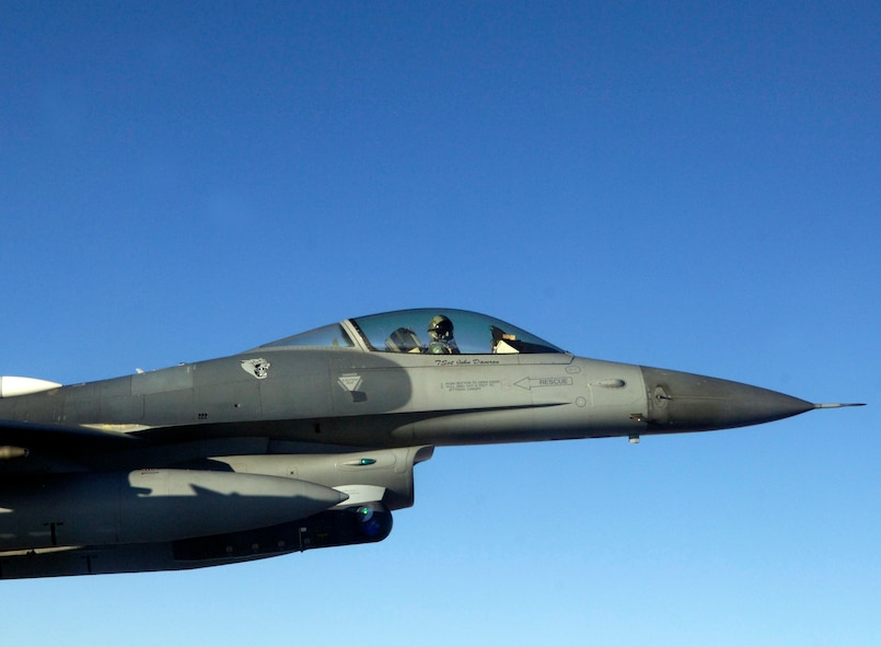 A F-16 from the 140th Fighter Wing, Buckley Air National Guard Base, CO, guides a C-21 from the 458th Airlift Squadron, Scott Air Force base, Ill Dec. 13 during Felix 12-4, a Western Air Defense Sector exercise.  The short notice exercise involved two scenarios, one where the two C-21 pilots were unconscious and another where the plane had been hijacked with no radio contact. In both scenarios the F-16 intercepted the C-21 over Colorado to guide them home. (U.S. Air Force photo/ Airman 1st Class Jacob Eckhardt)
