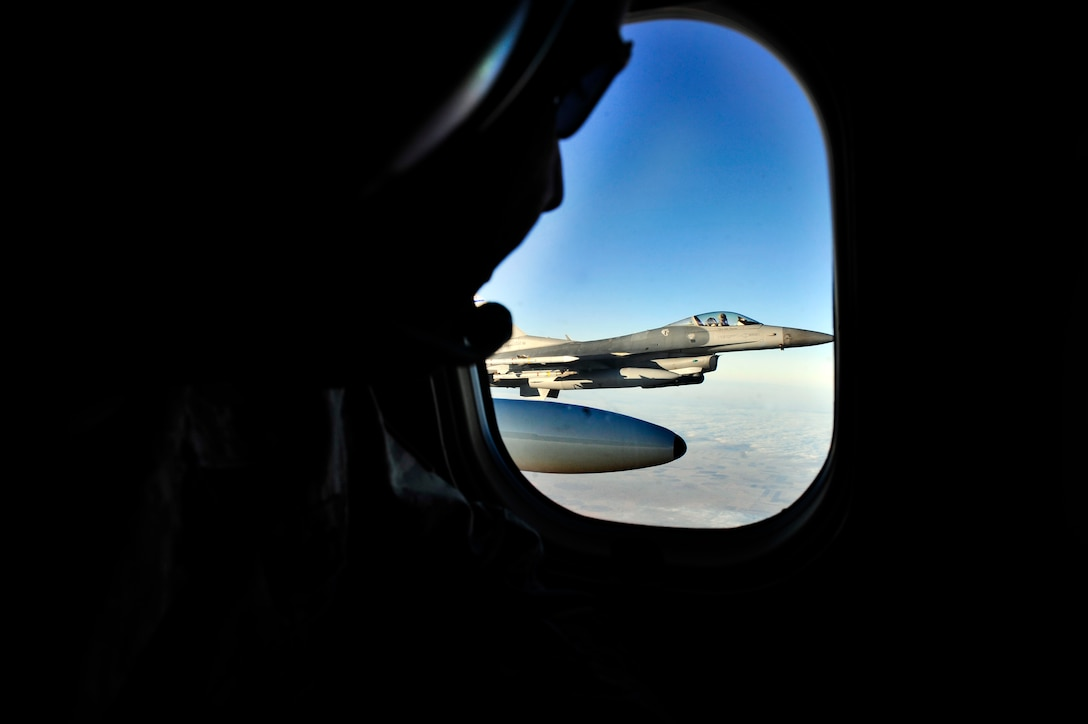 A F-16 from the 140th Fighter Wing, Buckley Air National Guard Base, CO, guides a C-21 from the 458th Airlift Squadron, Scott Air Force base, Ill Dec. 13 during Felix 12-4, a Western Air Defense Sector exercise.  The short notice exercise involved two scenarios, one where the two C-21 pilots were unconscious and another where the plane had been hijacked with no radio contact. In both scenarios the F-16 intercepted the C-21 over Colorado to guide them home. (U.S. Air Force photo/ Staff Sgt. Stephenie Wade)