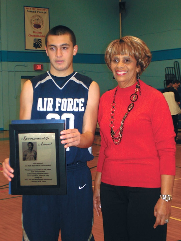U.S. Air Force Academy Preparatory School point guard and San Antonio native Cole Martinez receives the Joe Hall Sportsmanship award from Mabel Hall. (Courtesy photo)