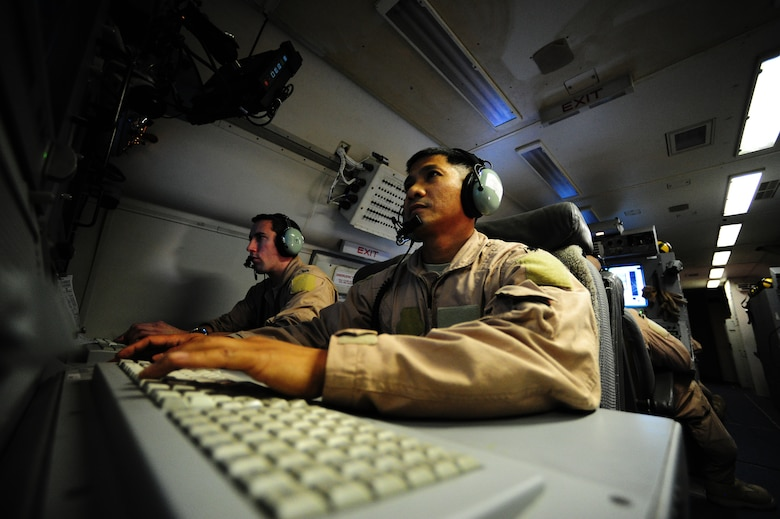 U.S. Air Force Lieutenant Colonel Joseph Paguiligan a Joint Surveillance Target Attack Radar System (JSTARS) mission crew commander from the 7th Expeditionary Air Combat Command Squadron, conduct operations as he and his fellow aircrew escorts the last ground convoy out of Iraq 18 Dec, 2011. Paguiligan was on the first JSTARS mission into Iraq. The JSTARS provided airborne, stand-off range, surveillance and target acquisition radar and command and control capabilities to ground personnel. Paguiligan is from Jersey City, N.J.(U.S. Air Force photo/ Tech. Sgt. DeNoris A. Mickle)