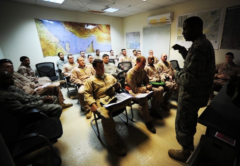 U.S. Air Force and Army personnel receive a crew brief from Colonel Randal Reed, 379th Expeditionary Operations Group Commander, before departing to escort the last ground convoy out of Iraq 18 Dec, 2011. This was the last Joint Surveillance Target Attack Radar System (JSTARS) combat mission over Iraqi air space. The JSTARS provided airborne, stand-off range, surveillance and target acquisition radar and command and control capabilities to ground personnel. (U.S. Air Force photo/ Tech. Sgt. DeNoris A. Mickle)