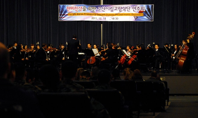 The Gunsan Philharmonic Orchestra brought holiday cheer to Kunsan's Wolf Pack in the form of a U.S.-Korea Friendship Concert in the base theater at Kunsan Air Base, Republic of Korea, Dec. 14, 2011. Members of both the U.S. Air Force and Republic of Korea Air Force joined the orchestra in song as they celebrated the special time of year together as one family working to accomplish one mission for the ROK. (U.S. Air Force photo by Senior Airman Derrick Schwieters/Released)