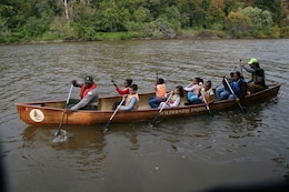 Washington D.C. -- Theodis Williams, park ranger with Mobile District (left), leads a group of school children on a canoe ride of the Anacostia River during the Urban Wilderness Canoe Adventures program, which began Oct. 24 and lasted one week.
