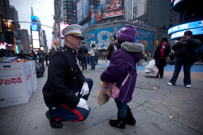 Marines from 6th Communication Battalion, a Marine Forces Reserve unit based in Floyd Bennett Field, Brooklyn, collect toys in Times Square as part of their Toys for Tots drive, Dec. 19. The Marines will be in Times Square all week loading up their tactical vehicles with toys collected from all of their New York City drop off locations as part of their final collection effort. Last year the Marines from 6th Communication Battalion collected approximately 280,000 toys, the majority of them being collected during this last-week scramble before Christmas.