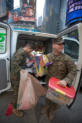 NEW YORK -- Marines from 6th Communication Battalion, a Marine Forces Reserve unit based in Floyd Bennett Field, Brooklyn, collect toys in Times Square as part of their Toys for Tots drive, Dec. 19. The Marines will be in Times Square all week loading up their tactical vehicles with toys collected from all of their New York City drop off locations as part of their final collection effort. Last year the Marines from 6th Communication Battalion collected approximately 280,000 toys, the majority of them being collected during this last-week scramble before Christmas. (Official Marine Corps photo by Cpl. Caleb Gomez / RELEASED)