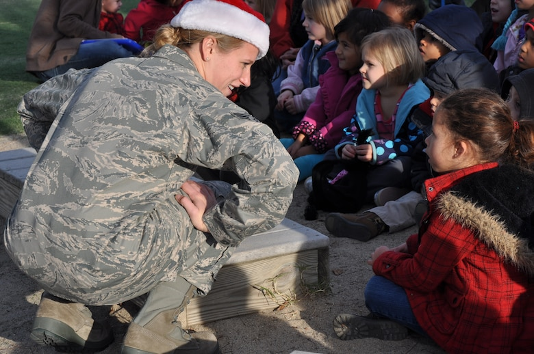 Senior Airman Megan Hokaj greets a young fan after a holiday show at the Child Development Center at Beale Air Force Base Calif., Dec. 14 2011. Hokaj is a member of the band Mobility based at Travis AFB. (U.S. Air Force photo by Staff Sgt. Robert M. Trujillo/Released)