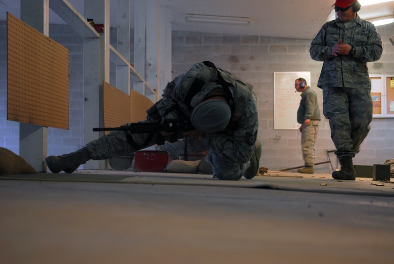 Prior to deploying in support of the POMLT 4 mission, members of the 171st Security Forces Squadron perform weapon qualification on the M-4 rifle and M-9 pistol. A police operational mentor and liaison team, POMLT4 will spend the next year training and teaching Afghan military and police on security tactics in Afghanistan. (National Guard photo by Tech. Sgt. Stacy Gault)