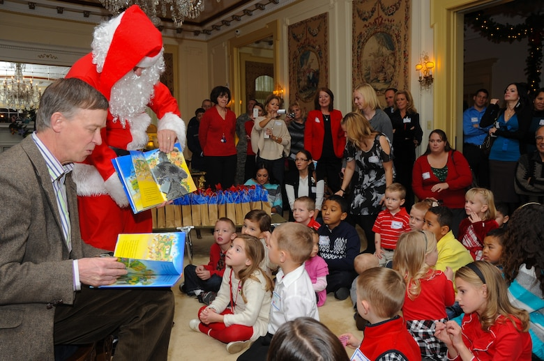 Colorado National Guard families enjoy crafts, cookies and a special holiday story at the Beottcher Mansion, Dec. 19, 2011, in Denver. Colorado Gov. John Hickenlooper hosted the holiday reception for the family members of deployed Colorado National Guardsmen. Hickenlooper and Santa Claus arrived on the scene via a holiday humvee. (Official Colorado National Guard photo by Master Sgt. Cheresa D. Theiral)