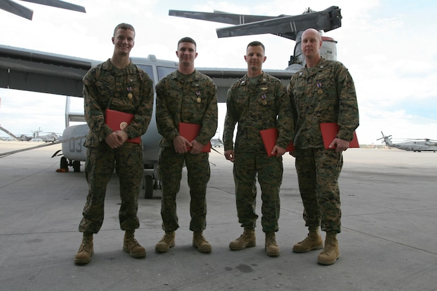Marines from Marine Medium Tiltrotor Squadron 264 were awarded the Air Medal for heroic actions in support of Operation Enduring Freedom, Dec. 16. (From left to right) Cpl. John M. Cederholm, the mission crew chief, Sgt. Justin K. Bartfield-Smith, the mission aerial gunner and observer, Capt. Matthew A. Cave, the mission co-pilot, and Capt. Thomas M. Keech, the mission pilot, were recognized for actions during a priority re-supply mission in support of 1st Battalion, 5th Marine Regiment, in the Sangin River Valley, Afghanistan, June, 12. This mission was the first time an MV-22B had engaged an enemy in Afghanistan.
