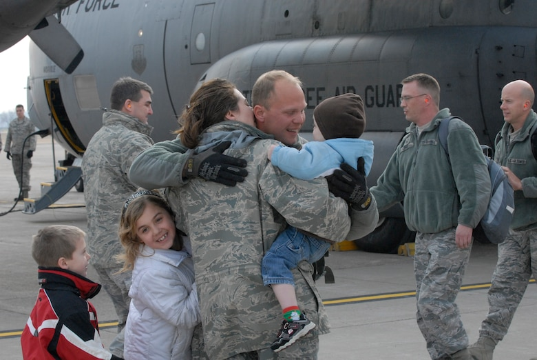 Joyful families embrace at the air guard base at the Minneapolis – St. Paul international airport on Dec. 21, 2011, as forty airmen disembark from an aircraft, returning from six months in Kuwait supporting Operation New Dawn. The airmen are from the 133rd Civil Engineer Squadron of the Minnesota Air National Guard and have been working with buildings and utilities at bases in Kuwait as the U. S. military pulled out of Iraq. Minnesota National Guard photo by Sgt. Johnny Angelo