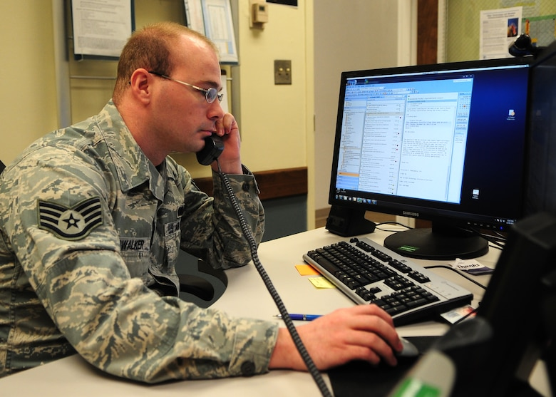 Staff Sgt. Carys Cloudwalker, 9th Communications Squadron NCO in charge of the Communications Focal Point, troubleshoots a help desk ticket for a commander Dec. 21, 2011. Cloudwalker and other Comm. Airmen can remote into other computer, enabling them to solve issues without dispatching a technician. (U.S. Air Force photo by Senior Airman Shawn Nickel/Released)