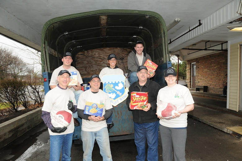 Airmen from the 107th Airlift Wing along with mission staff unloaded boxes of food, canned goods and frozen turkeys stocking up the food pantry at the Niagara Falls Community Mission. Front row; Master Sgt. Steven Buja, Tech. Sgt. Paul Wiegand, Master Sgt. Mark Lewandowski, Tech. Sgt. Amanda Doherty. Back row; Senior Airman Robert Kurzdorfer, Tech. Sgt. Krystatore Stegner and Airman 1st Class Tony Lewandowski. Front row; Master Sgt. Steven Buja, Tech. Sgt. Paul Wiegand, Master Sgt. Mark Lewandowski, Tech. Sgt. Amanda Doherty. Back row; Senior Airman Robert Kurzdorfer, Tech. Sgt. Krystatore Stegner and Airman 1st Class Tony Lewandowski. on December 21, 2011 (Air Force Photo/Senior Master Sgt Ray Lloyd)