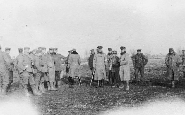 British and German troops meet in No-Man's Land during the Christmas truce.