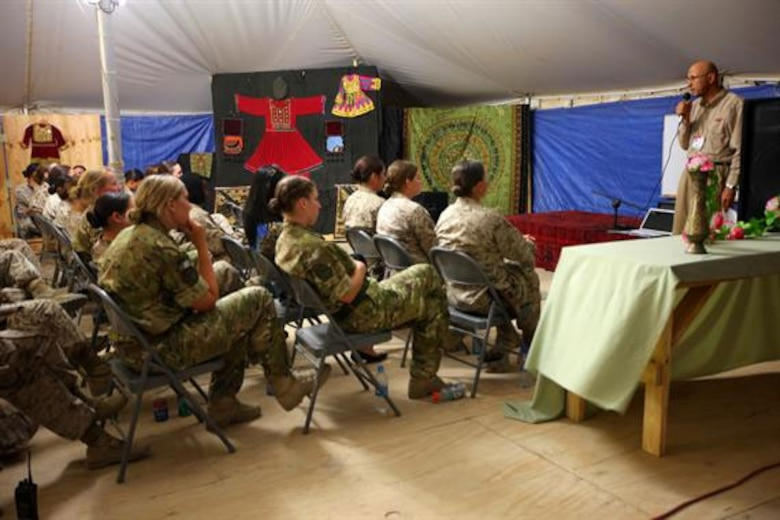 Linguists 'Essential Part' of Female Engagement Team Mission Gamaruddin Jabarkhiel (right), the cultural adviser for Regional Command Southwest, speaks to U.S. and U.K. Female Engagement Teams and their linguists during training at the Afghan Cultural Center on Camp Leatherneck, May 16. The FETs met to discuss progress made, share experiences and give advice regarding how to reach out to Afghan women.