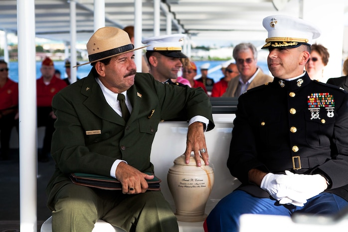 Daniel Martinez (left), a chief historian for Hawaii's National Park Service, and Col. Nathan Nastase (right), commanding officer of 3rd Marine Regiment, escort Frank R. Cabiness' urn to the USS Arizona Memorial here Dec. 23 for his interment ceremony. Cabiness was a part of the Marine detachment aboard the USS Arizona and survived the attacks on Pearl Harbor on Dec. 7, 1941.