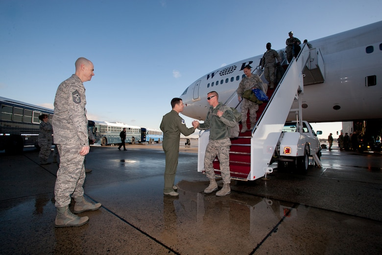 Returning Airman from the 113th DCANG step off from a 18 hours flight from Afghanistan to be greeted back home by Brigadier General Jeff Johnson and Chief  Master Sergeant Ronald Anderson. The Guard members returned home after a 60-day Air Expeditionary Force deployment to Afghanistan in support of Operation Enduring Freedom. Of the 200 deployers, more than 170 were from the District of Columbia Air National Guard???s 113th Wing.  Augmenting the 113th Wing were other Air National Guard members from Iowa, New Jersey, Alabama, and Texas. (U.S.  Air Force photo by Tech Sgt Gareth Buckland/Released)