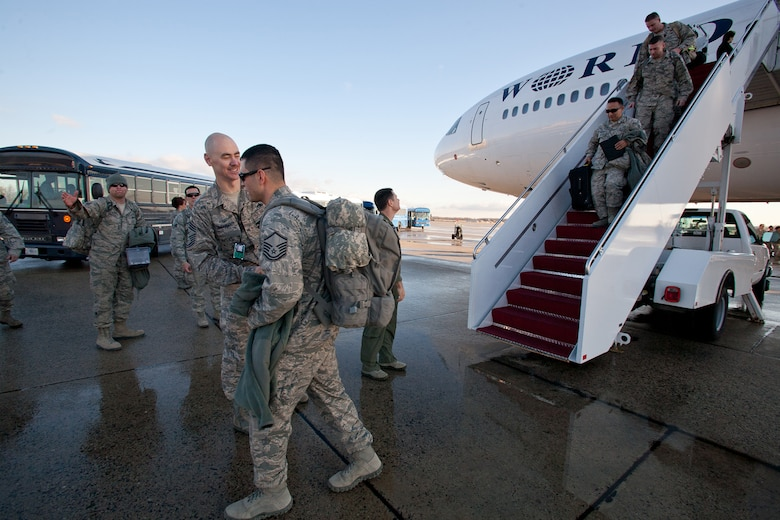 Returning Airman from the 113th DCANG step off from a 18 hours flight from Afghanistan to be greeted back home by Brigadier General Jeff Johnson and Chief  Master Sergeant Ronald Anderson. The Guard members returned home after a 60-day Air Expeditionary Force deployment to Afghanistan in support of Operation Enduring Freedom. Of the 200 deployers, more than 170 were from the District of Columbia Air National Guard's 113th Wing.  Augmenting the 113th Wing were other Air National Guard members from Iowa, New Jersey, Alabama, and Texas. (U.S.  Air Force photo by Master Sgt. Jessica Dearie/Released)