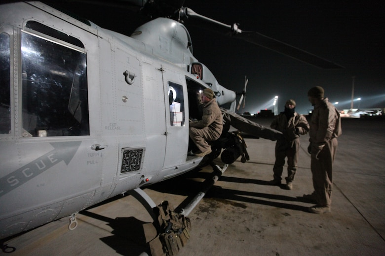 Lance Cpl. Andrew Harris, a crew chief with Marine Light Attack Helicopter Squadron 369, checks care packages loaded onto a Marine Corps UH-1Y Huey at Camp Bastion, Afghanistan, Dec. 25. The Marine Corps helicopter squadron flew thousands of pounds of care packages to infantry Marines at austere combat outposts in Afghanistan on Christmas Day.::r::::n::::r::::n::::r::::n::