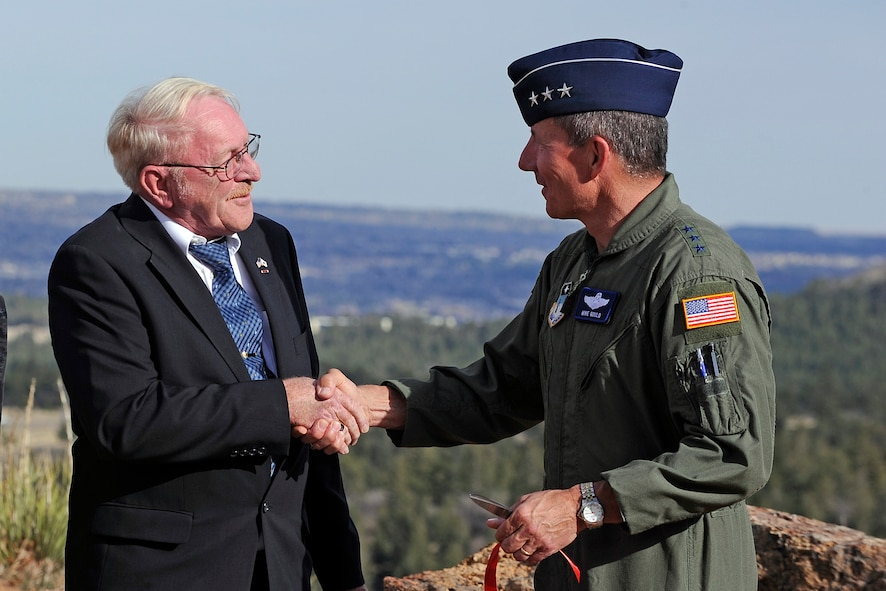 Rev. Dr. David Oringderff speaks with Lt. Gen. Mike Gould during a dedication ceremony for the Air Force Academy Cadet Chapel Falcon Circle May 3, 2011. Oringderff is the executive director of the Sacred Well Congregation and represented the Earth-Centered Spirituality community during a religious respect conference at the Academy in November 2010. Gould is the Academy superintendent. (U.S. Air Force photo/Mike Kaplan)
