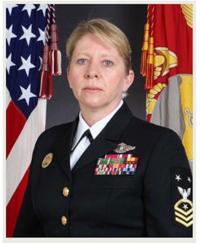 """A native of Newton Falls, Ohio, Master Chief Heap began her Naval service in January 1985. She completed basic training at Recruit Training Command, Orlando, Florida and transferred to Great Lakes, Illinois to attend and graduate from Hospital Corps """"A"""" School."""