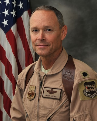 Lt. Col. Mitchell Lyons, 332nd Air Expeditionary Wing Plans and Programs office, is deployed from the 559th Flying Training Squadron at Randolph Air Force Base, Texas.  During his deployment he has helped oversee a part of the drawdown in Iraq and the transition to elsewhere in Southwest Asia.  (Courtesy Photo)