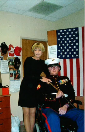 Sgt. Josh Cooley prepares to leave for the Marine Corps Ball with his mother Christine Cooley in Tampa Bay, Fla., in Nov. 2006. Cooley enlisted in the Corps after the terrorist attacks of Sept. 11, 2001 following ten years of service as a deputy on the SWAT team.